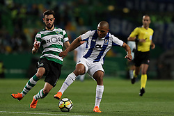 April 18, 2018 - Lisbon, Portugal - Porto's Algerian forward Yacine Brahimi (R ) vies with Sporting's midfielder Bruno Fernandes from Portugal during the Portugal Cup semifinal second leg football match Sporting CP vs FC Porto at the Alvalade stadium in Lisbon on April 18, 2018. (Credit Image: © Pedro Fiuza via ZUMA Wire)