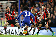 Willian of Chelsea looks for a way  past Bournemouth defenders. Barclays Premier league match, Chelsea v AFC Bournemouth at Stamford Bridge in London on Saturday 5th December 2015.<br /> pic by John Patrick Fletcher, Andrew Orchard sports photography.
