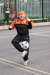 Teenage girls playing football UK