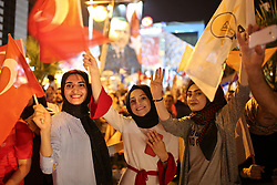 Supporters of Turkey's President and ruling Justice and Development Party, or AKP, leader Recep Tayyip Erdogan celebrate elections victory in Antalya, Sunday, June 24, 2018. Unofficial results from Turkey's presidential election show incumbent Recep Tayyip Erdogan with a commanding lead. Photo by Ibrahim Laleli/DHA/Depo Photos/ABACAPRESS.COM