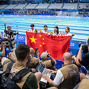 TOKYO, JAPAN - JULY 29: The world record breaking China team of Junxuan Yang, Yufei Zhang, Bingjie Li and <br />  Muhan Tang pose for a photograph with the Chinese flag after their gold medal win in the 4x 200m relay for womenduring the Swimming Finals at the Tokyo Aquatic Centre at the Tokyo 2020 Summer Olympic Games on July 29, 2021 in Tokyo, Japan. (Photo by Tim Clayton/Corbis via Getty Images)