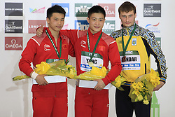 © Licensed to London News Pictures. London, UK. 27/04/2014. London, UK.  Men's winners Chinese AISEN CHEN,left, Chinese JIAN YANG and Ukranian OLEKSANDR BONDAR at the FINA Diving World Series final at the Aquatics Centre, Queen Elizabeth Olympic Park. Photo credit: LNP