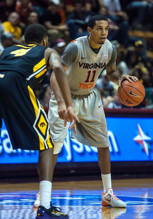 Nov 27, 2012; Blacksburg, VA, USA; Virginia Tech Hokies guard Erick Green (11) handles the ball against the Iowa Hawkeyes at Cassell Coliseum. Mandatory Credit: Peter Casey-USA TODAY Sports