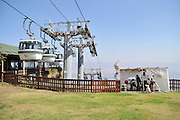 Israel, Upper Galilee, Manara cliff, on the Lebanese border overlooking the Hula Valley. The cable car descending to Kiryat Shmona in the valley below A Sukkah on the lawn under the cars