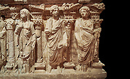 """Roman relief sculpted sarcophagus of Domitias Julianus and Domita Philiska, 2nd century AD, Perge. Antalya Archaeology Museum, Turkey.<br /> <br /> <br /> it is from the group of tombs classified as. """"Columned Sarcophagi of Asia Minor"""". <br /> The lid of the sarcophagus is sculpted into the form of a """"Kline"""" style Roman couch on which lie Julianus &  Philiska. This type of Sarcophagus is also known as a Sydemara Type of Tomb. . Against a black background. ..<br /> <br /> If you prefer to buy from our ALAMY STOCK LIBRARY page at https://www.alamy.com/portfolio/paul-williams-funkystock/greco-roman-sculptures.html . Type -    Antalya    - into LOWER SEARCH WITHIN GALLERY box - Refine search by adding a subject, place, background colour, etc.<br /> <br /> Visit our ROMAN WORLD PHOTO COLLECTIONS for more photos to download or buy as wall art prints https://funkystock.photoshelter.com/gallery-collection/The-Romans-Art-Artefacts-Antiquities-Historic-Sites-Pictures-Images/C0000r2uLJJo9_s0"""