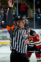 KELOWNA, BC - FEBRUARY 15: Referee Matt Hicketts raises his arm for the penalty call on the Kelowna Rockets against the Red Deer Rebels at Prospera Place on February 15, 2020 in Kelowna, Canada. (Photo by Marissa Baecker/Shoot the Breeze)