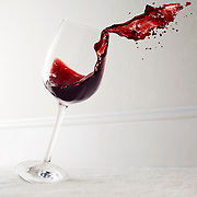 Glass of red wine falling over onto a carpet Ray Massey is an established, award winning, UK professional  photographer, shooting creative advertising and editorial images from his stunning studio in a converted church in Camden Town, London NW1. Ray Massey specialises in drinks and liquids, still life and hands, product, gymnastics, special effects (sfx) and location photography. He is particularly known for dynamic high speed action shots of pours, bubbles, splashes and explosions in beers, champagnes, sodas, cocktails and beverages of all descriptions, as well as perfumes, paint, ink, water – even ice! Ray Massey works throughout the world with advertising agencies, designers, design groups, PR companies and directly with clients. He regularly manages the entire creative process, including post-production composition, manipulation and retouching, working with his team of retouchers to produce final images ready for publication.