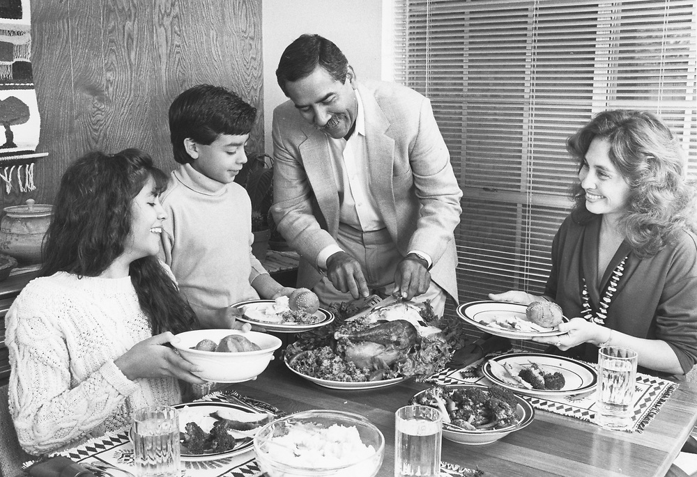 ©1990 Hispanic Families in the USA: The Alcorta family of Austin, Texas having dinner MR ES-0506 color available.