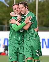22/07/15 UEFA CHAMPIONS LEAGUE QUALIFIER 2ND LEG<br /> STJARNAN v CELTIC <br /> STJORUVOLLUR - ICELAND<br /> Celtic's Leigh Griffiths (left) celebrates with Stefan Johansen