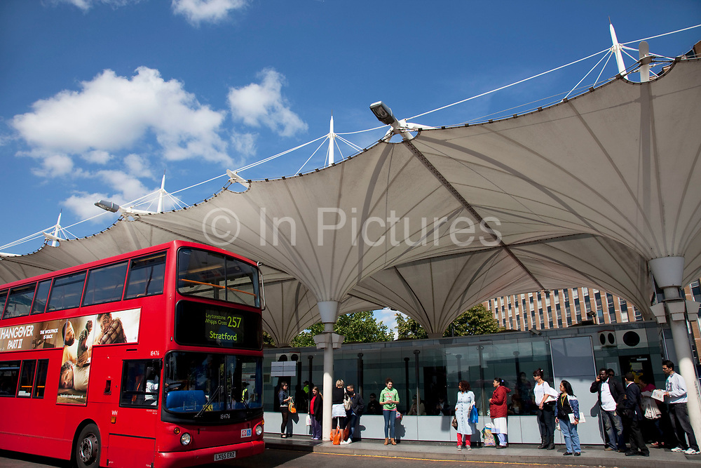 Scene in Stratford in East London. Stratford Bus Station serves the Stratford area of the London Borough of Newham, London, England. The station is owned and maintained by Transport for London. The station can be accessed from Great Eastern Road as well as Stratford tube, DLR and railway station. This is a relatively poor area of London, but in recent years has seen much regeneration, the construction of a major transport hub and various shopping complexes. Stratford is adjacent to the London Olympic Park and is currently experiencing regeneration and expansion linked to the 2012 Summer Olympics. (Photo by Mike Kemp/For The Washington Post)