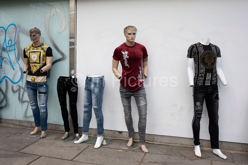 Scene with male mannequins in a state of decay in the now almost empty Elephant and Castle outdoor market in London, UK. The area is now subject to a master-planned redevelopment budgeted at £1.5 billion. A Development Framework was approved by Southwark Council in 2004. It covers 170 acres and envisages restoring the Elephant to the role of major urban hub for inner South London.