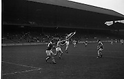 MInor Hurling, Kerry v Antrim..W. McCarthy (14), Kerry full forward, reaches for the ball as it sails past J. Mulholland (2) and N. McMullan, Antrim full backs.  J. Gannon (extreme right) waits to see what will happen..05.10.1969.