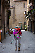Pilgrim walker on the Camino de Santiago de Compostela route arrives in Santo Domingo de la Calzada in Castilla y Leon, Spain