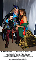 The MARQUESS OF BATH and MISS TRUDI JUGGERNAUT-SHARMA at an exhibition in London on 9th February 2004.PRM 185