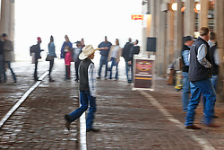 Silhouettes of people walking through Stockyards Station,  Fort Worth Stockyards National Historic District, Fort Worth, Texas, USA.