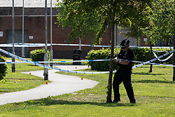 © Licensed to London News Pictures. 28/05/2018. Stockport, UK. Police at the scene outside The Salisbury Club on Truro Avenue in the Brinnington area of Stockport, Greater Manchester, where a car collided with pedestrians late last night, killing one man and injuring others.  A murder investigation has been launched. Police later recovered a black Audi A4 which fled the scene. Photo credit: Joel Goodman/LNP