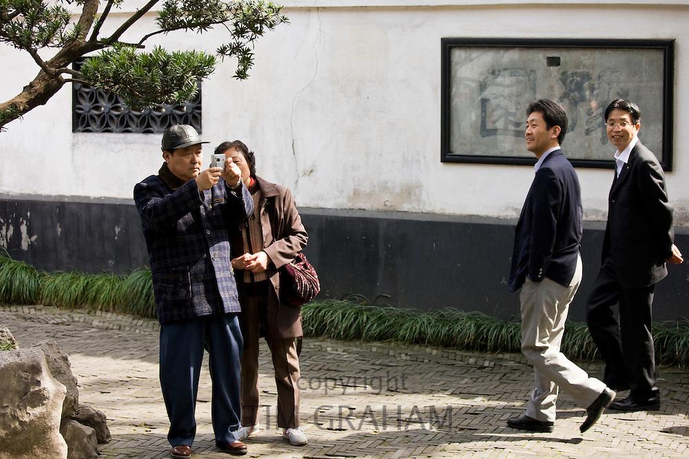 Visitors in the Yu Gardens, Shanghai, China