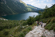 People ascend a slope connecting Morskie Oko to Czarny Staw in Tatra National Park, Poland (August 29, 2016)