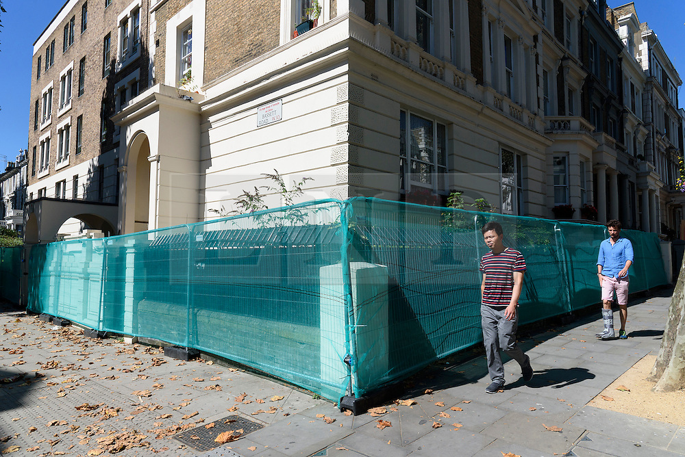 © Licensed to London News Pictures. 26/08/2016.  A residential property fenced off  Notting Hill ahead of the annual Notting Hill Carnival which starts this bank holiday weekend.  London, UK. Photo credit: Ray Tang/LNP