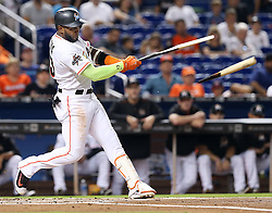 August 15, 2017 - Miami, FL, USA - The Miami Marlins' Marcell Ozuna hits a single in the first inning against the San Francisco Giants at Marlins Park in Miami on Tuesday, Aug. 15, 2017. (Credit Image: © Pedro Portal/TNS via ZUMA Wire)