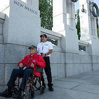 Lawrence Talamante, 94, and his son Nestor Talamante, standing, stand underneath the New Mexico pillar in the WWII memorial in Washington D.C. Jun. 06.