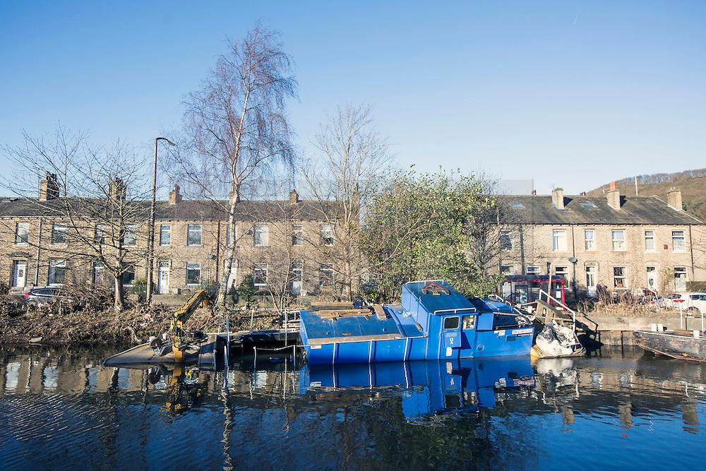 © Licensed to London News Pictures. 29/12/2015. Elland UK. Picture shows a sunken barge on the Calder & Hebble Navigation at Greenway in Elland after recent flooding.  Photo credit: Andrew McCaren/LNP