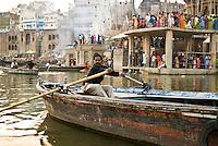 A boatman on the River Ganges during the festival of Kartik Poornima in Varanasi, Uttar Pradesh, India