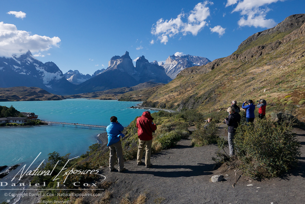 Explorers taking in the great photo opps in Torres del Paine National Park. Patagonia, Argentina