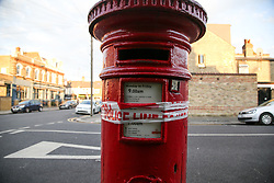 © Licensed to London News Pictures. 11/07/2020. London, UK. Leftover of a police tape on a postbox near Westbury Avenue in Wood Green, north London, following a stabbing. A 23 year old man was stabbed in Westbury Avenue at 10.40pm on Friday 10 July. The victim was to hospital where his condition has been assessed as critical. Photo credit: Dinendra Haria/LNP