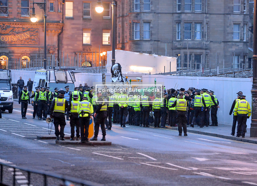 Pictured: Into the evening there was still a hard core of protesters, heavily outnumbered by police, who refused to move.<br /> <br /> Extinction Rebellion Scotland hosted a demo in which protestors were encouraged to block traffic on North Bridge, Edinburgh, in a bid to highlight the climate change issue, as part of a co-ordinated nationwide action.<br /> <br /> © Dave Johnston/ EEm