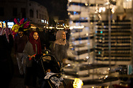 Two women look at a shop in Souk Waqif, a popular pedestrian area in Doha, Qatar