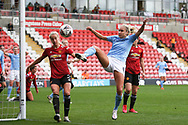 Manchester City defender Steph Houghton (6) shoots on goal during the FA Women's Super League match between Manchester United Women and Manchester City Women at Leigh Sports Village, Leigh, United Kingdom on 14 November 2020.