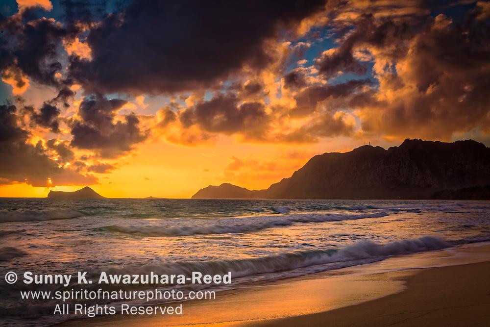 Sunrise over Rabbit Island and Koʻolau Range, Bellows Beach. Oahu Island, Hawaii.