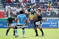 Neil Powell claims the high ball for South Africa during the XIX Commonwealth Games 7s rugby match between South Africa and India held at The Delhi University in New Delhi, India on the  11 October 2010..Photo by:  Ron Gaunt/photosport.co.nz