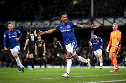 Everton's Theo Walcott celebrates scoring his side's second goal of the game during the Premier League match at Goodison Park, Liverpool.