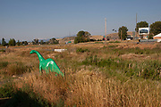 Green dinosaur at a gas station on 7th August 2007 at Emigrant, Montana, United States.