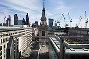 The spire of St Mary-le-Bow from the roof of One New Change, London UK.  A historic church rebuilt after the Great Fire of 1666 by Sir Christopher Wren in the City of London.  According to tradition a true Cockney must be born within earshot of the sound of Bow Bells.