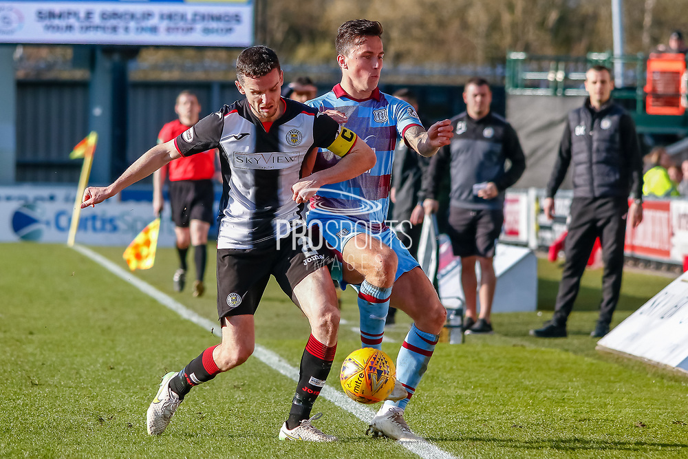 Paul McGinn (C) of St Mirren chases down John O'Sullivan of Dundee FC during the Ladbrokes Scottish Premiership match between St Mirren and Dundee at the Paisley 2021 Stadium, St Mirren, Scotland on 30 March 2019.