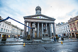 The equestrian Wellington Statue, most often featured with a traffic cone on its head, on Royal Exchange Square in Glasgow, Scotland, during the filming off Trainspotting on Queen Street, Glasgow on the night of 20th June 2016.