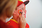 Chris Kjeldgaard, 12, of Oakdale, has his face painted by his mom, Lisa, before the special Friday Night Lights game between Oakdale and Manteca High School at Levi's Stadium in Santa Clara, California, on October 11, 2014. (Stan Olszewski/ Special to The Record)