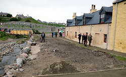 The Prince of Wales, known as the Duke of Rothesay while in Scotland, walks with Roger Goodyear during a visit to Sail Loft Bunkhouse, Portsoy where he willl met members of the restoration team who have converted 18th century sailmakers' cottages into the 25-bed Sail Loft Bunkhouse.