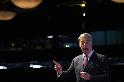 """© Licensed to London News Pictures . 25/05/2016 . Bolton , UK . NIGEL FARAGE speaks . Nigel Farage , Kate Hoey and Paul Nuttall at a """" We Want Our Country Back """" public meeting in favour of the UK leaving the EU at the Premier Suite of Bolton Wanderers' Macron Stadium . Photo credit : Joel Goodman/LNP"""