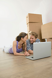 Happy couple computer planning new home