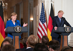 United States President Donald J. Trump and Chancellor Angela Merkel of Germany shake hands after conducting a joint press conference in the East Room of the White House in Washington, DC on Friday, April 27, 2018. Credit: Ron Sachs / CNP. 27 Apr 2018 Pictured: United States President Donald J. Trump and Chancellor Angela Merkel of Germany conduct a joint press conference in the East Room of the White House in Washington, DC on Friday, April 27, 2018. Credit: Ron Sachs / CNP. Photo credit: Ron Sachs - CNP / MEGA TheMegaAgency.com +1 888 505 6342