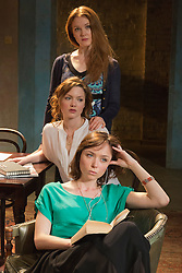 """© Licensed to London News Pictures. 07/04/2014. London, England. Pictured: top to bottom: Olivia Hallinan as Olga; Holliday Grainger as Irina and Emily Taaffe as Masha. The play """"Three Sisters"""" by Anton Chekhov, in a new version by Anya Reiss, opens at the Southwark Playhouse, London, with Paul McGann as Vershinin, Olivia Hallinan as Olga, Emily Taaffe as Masha and Holliday Grainger as Irina. Directed by Russel Bolam. Photo credit: Bettina Strenske/LNP"""