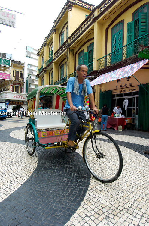 Rickshaw taxi in central square of historic Macau in China
