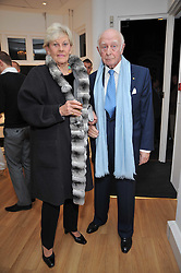 PRINCE & PRINCESS RUPERT LOWENSTEIN at a private view of photographs by Marina Cicogna from her book Scritti e Scatti held at the Little Black Gallery, 3A Park Walk London SW10 on 16th October 2009.