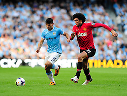 Manchester United's Marouane Fellaini closes down Manchester City's Sergio Aguero - Photo mandatory by-line: Dougie Allward/JMP - Tel: Mobile: 07966 386802 22/09/2013 - SPORT - FOOTBALL - City of Manchester Stadium - Manchester - Manchester City V Manchester United - Barclays Premier League