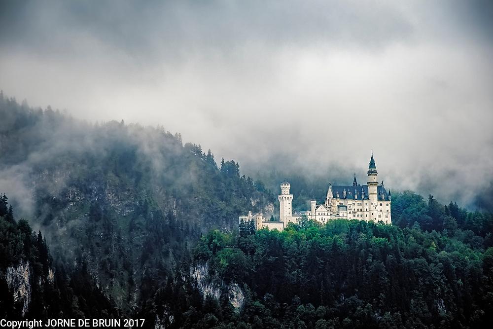 Neuschwanstein Castle surrounded by mist in the Bavarian Alps