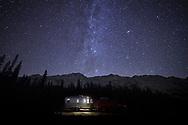 Nighttime camping under the stars in a recreational vehicle in Jasper National Park, Alberta, Canada.